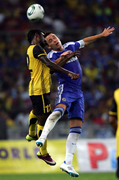 John Terry John Terry (R) of Chelsea clashes with Gary Stevan of Malaysia during the pre-season friendly match between Malaysia and Chelsea at Bukit Jalil National Stadium on July 21, 2011 in Kuala Lumpur, Malaysia.