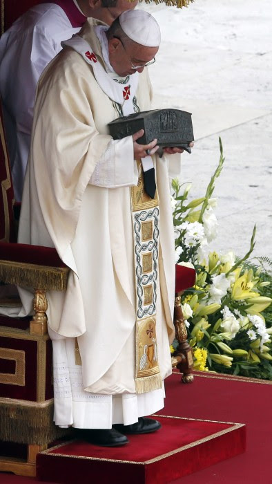 Pope Francis holds the relics of the Apostle Peter on the altar during a mass at St. Peter's Square at the Vatican