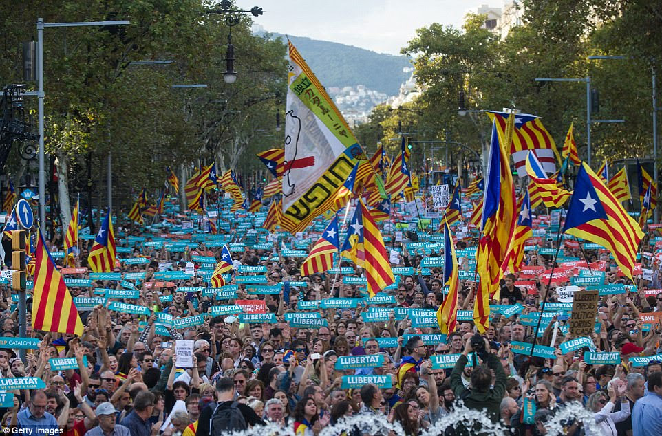 Thousands of pro-independence campaigners carried banners saying Llibertat - freedom - during the lively protests which began earlier today and carried on into this evening