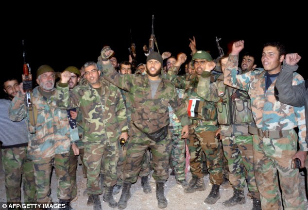 Volatile fighting: The news of the kidnapping and beheading of Mr Arbashe came as pro-government forces celebrated their victory against rebels at the Air Defence Base in Tal Hassil near from Aleppo Airport last night
