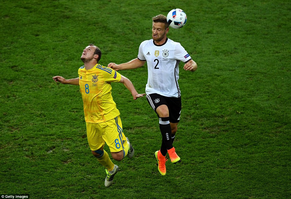 Dnipro Dnipropetrovsk forward Roman Zozulya goes up for the ball with Mustafi at the Stade Pierre-Mauroy in Villeneuve-d'Ascq, near Lille