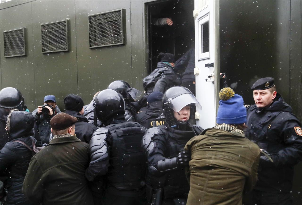 Belarus police detain protesters during an opposition rally in Minsk, Belarus, Saturday, March 25, 2017. A cordon of club-wielding police blocked the demonstrators' movement along Minsk's main avenue near the Academy of Science. Hulking police detention trucks were deployed in the city center.