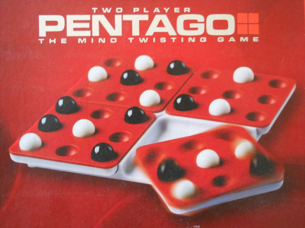 Detail of Pentago board game box, with cover illustration showing the board rotating.