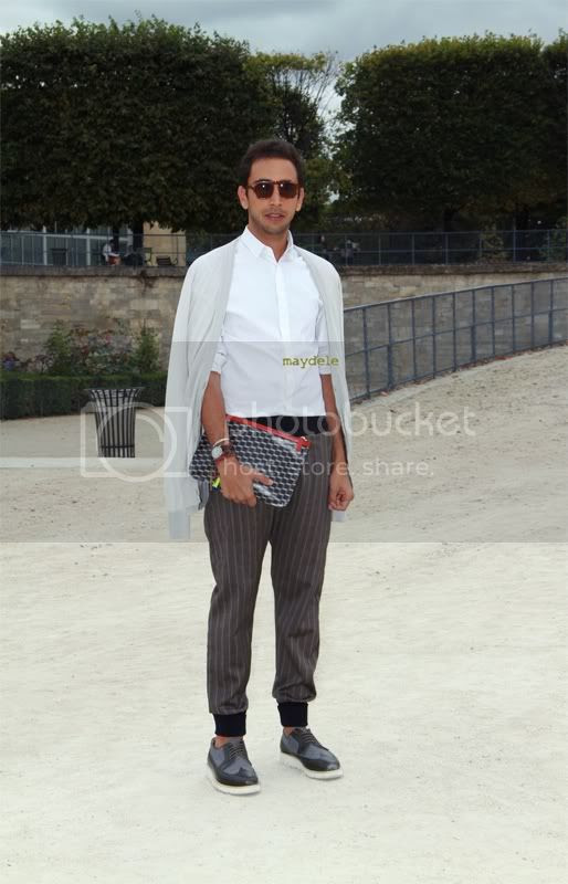Amine Jressaiti carrying Pierre Hardy cube-print portfolio pouch