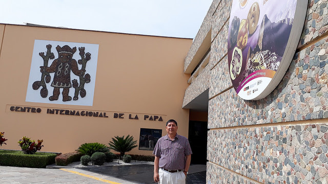 Miguel Ordinola stands in front of the Lima headquarters of the International Potato Centre, a non-governmental scientific body that is part of the Organising Committee of the World Potato Congress, which will be hosted in the Peruvian city of Cuzco in May. Credit: Mariela Jara / IPS