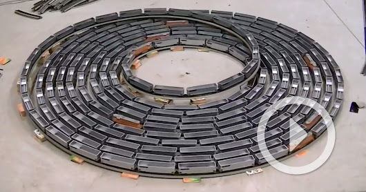A Hypnotic Infinite Model Train Loop that Travels Rapidly in Either Direction