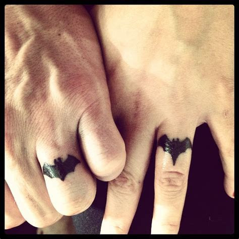 Batman/Batgirl wedding ring tattoo. My husband and I
