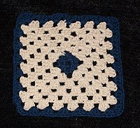 A granny square worked in two colors and seven rounds.  Cotton, 4mm crochet hook.