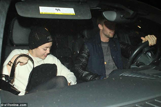 Doesn't care who knows: Miley didn't stop smiling as she was whisked away by Patrick in his car