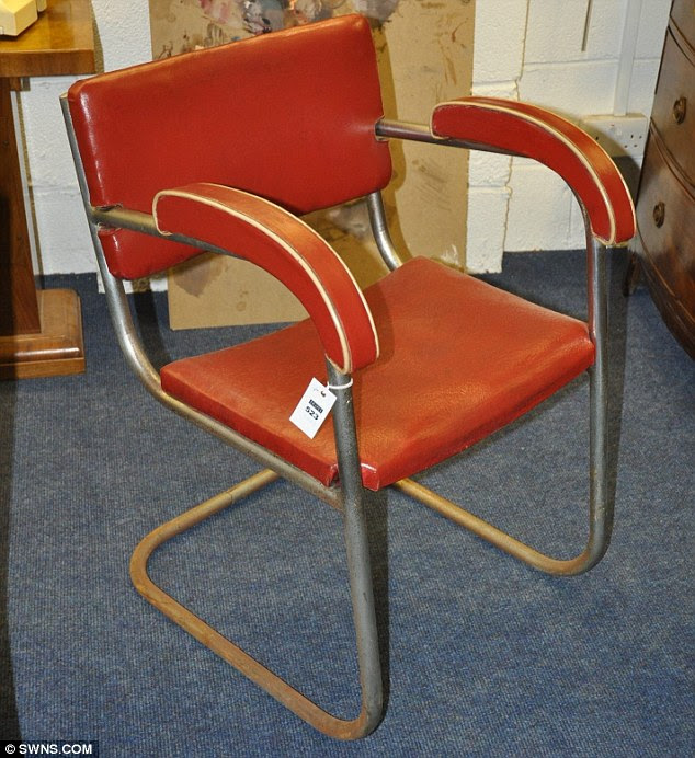 Bargain: This 1950s-style red chair from paintings 'Critical Hour', 'Self Portrait' and 'Rachel in the Studio' will also be sold. Most of the items - including those featured in his art - are expected to fetch just a few pounds
