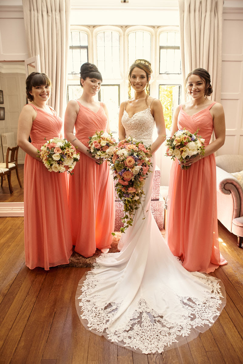 Bride and Bridesmaids indoors at Lanwades Hall Wedding Photos - helloromancephotography.com