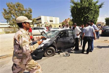 Libyan rebel intelligence personnel attacked in Benghazi. The country has been experiencing a spat of attacks against the U.S.-backed GNC regime. by Pan-African News Wire File Photos