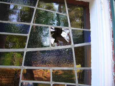 Broken stained glass window