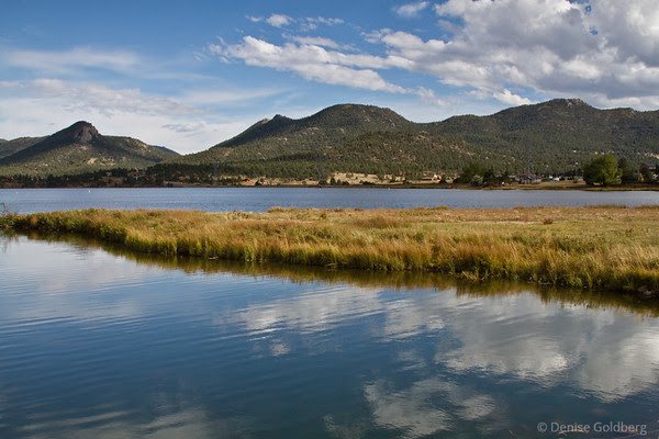 blue sky, clouds, reflecting in Lake Estes