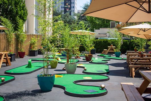 Hotel transforms parking lot into mini golf course