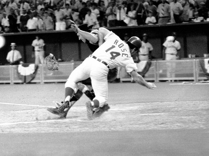 THE COLLISION -- In a controversial ending to the 1970 All-Star Game at Riverfront Stadium in Cincinnati, Pete Rose plowed into the body of catcher Ray Fosse to score the winning run in the bottom of the 12th inning. Fosse fractured his shoulder and never regained All-Star form.