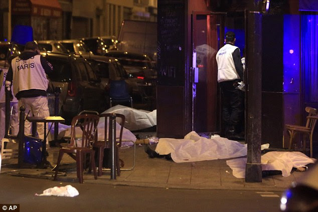 Victims lay on the pavement outside Paris restaurant following a terror attack in the French capital tonight