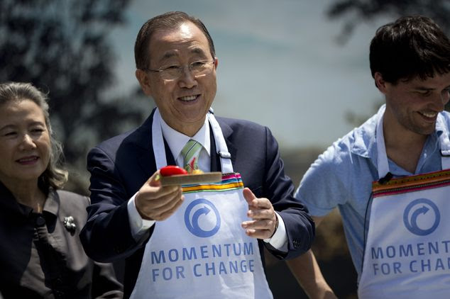 UN Secretary General Ban Ki-moon shows a  Peruvian dish called ceviche during the presentation of ecological stoves at the UN Climate Change Conference in Li...