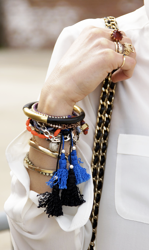 LE FASHION BLOG JEWELRY POST STATEMENT WRIST VIA BYRDIE FRINGED TASSEL BRACELETS STACKED WRIST ARM PARTY DIAMOND BANGLES LEATHER GOLD BRACELETS CUFFS FRIENDSHIP BRACELETS BEADED CRISP WHITE POCKET SHIRT TOP CHAIN STRAP BAG VINTAGE RINGS PINKIE PINKY RING photo LEFASHIONBLOGJEWELRYPOSTSTATEMENTWRISTVIABYRDIE.png