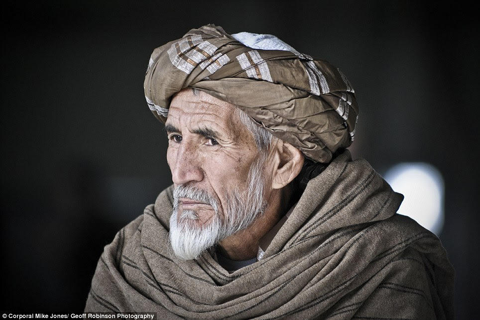this sombre portrait was captured by Corporal Mike Jones RAF, who photographed an Afghan Elder as he watched over his family as they took part in an Afghanistan Air Force open day at Kandahar Air Base