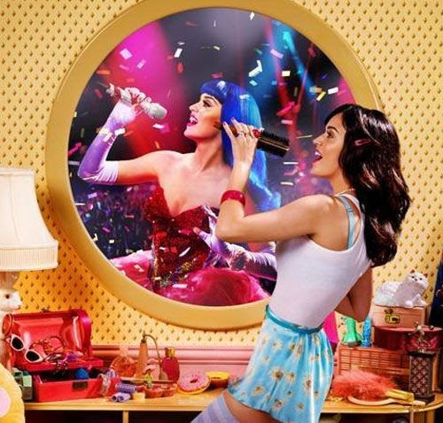Katy Perry and her blue-haired alter-ego in KATY PERRY: PART OF ME.