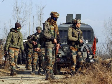 Army soldiers take positions during an encounter with militants at Sirnoo in Pulwama. PTI