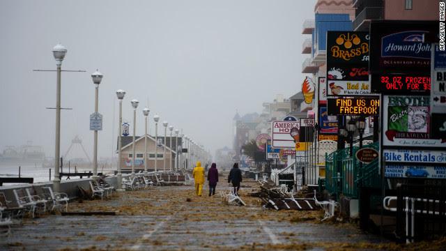 People walk on the boardwalk in Ocean City, Maryland, on Monday.