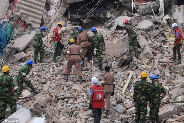 Grim search: Around 3,000 workers - mainly young women - had gone to work in the eight-storey building last Wednesday morning, despite huge cracks appearing in the walls the day before