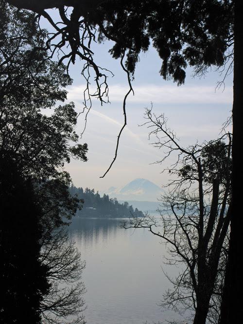 a hazy Lake Washington scene with Mount Rainier, Seattle