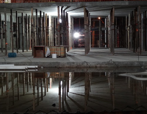 construction site reflections in water by zen
