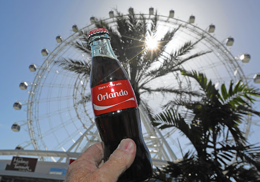 Orlando Eye officially flies Coca-Cola banner