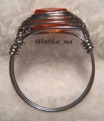 close up herringbone weave crystal rings