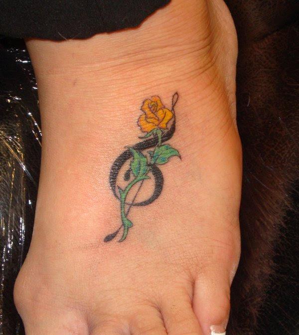 Treble Clef And Rose Tattoo Foot Tattoo Design Tattoomagz