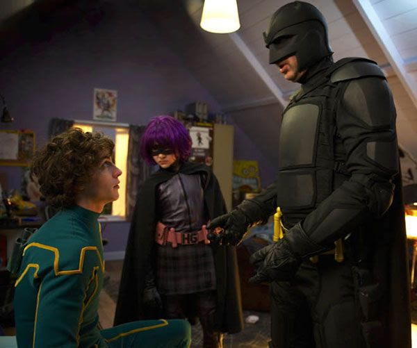 At his house, Kick-Ass is visited by Hit-Girl and her father, Big Daddy in KICK-ASS.