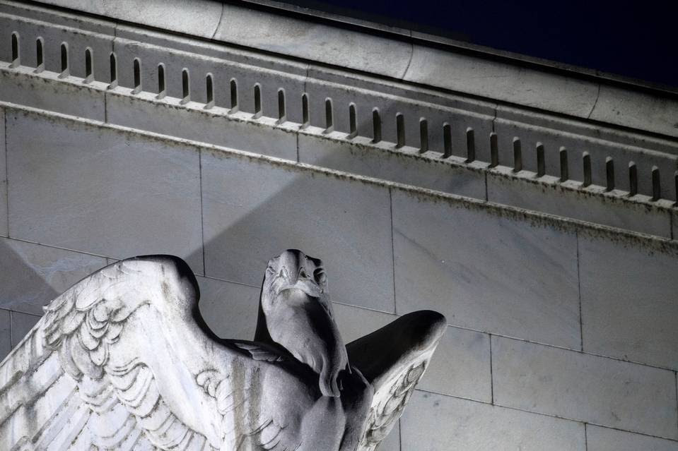 An eagle, designed by Sidney Waugh, sits above the main portico of the Federal Reserve Building in Washington, D.C.