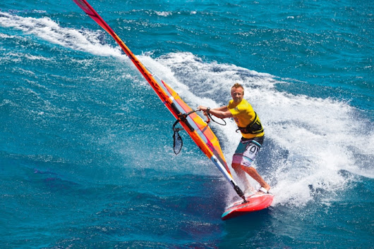 Feel the rhythm, feel the glide – time to blast and free your windsurfing ride!