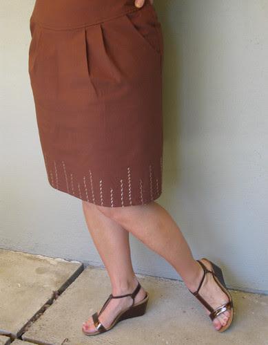 Brown skirt pleats