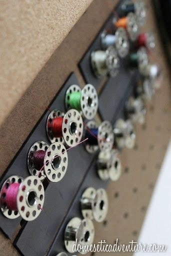 Store bobbins on magnet strips - genius! Click here for the magnet material needed: http://www.emagnets.com/indoor-adhesive-magnetic-strips-2-wide.html