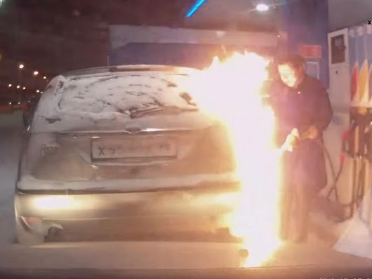 Woman sets her car on fire at gas station in Russia - Road Traffic Fail Videos