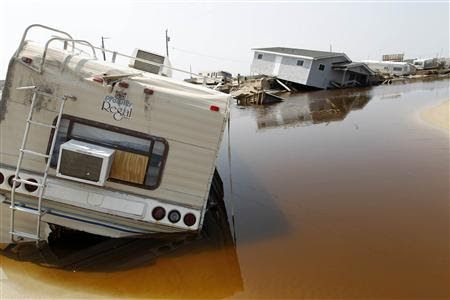 A trailer sits on the beach at the North Beach Campground after being washed out by Hurricane Irene, at Cape Hatteras National Seashore in Rodanthe