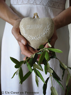 Linen heart and branche of olive tree