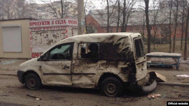A burned-out car in Mariupol following a January 24 rocket attack on the city that killed dozens of civilians.