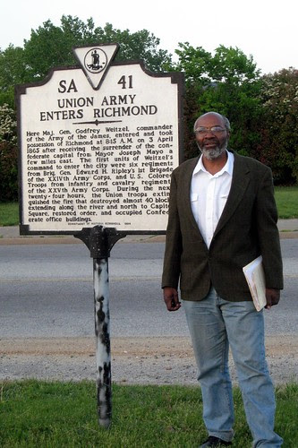 Abayomi Azikiwe, editor of the Pan-African News Wire, standing next to the marker recognizing the role of African troops in liberating Richmond at the conclusion of the Civil War. (Photo: Ana Edwards) by Pan-African News Wire File Photos