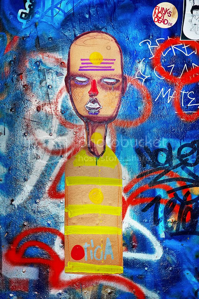 Hieratic Paper Figure on Graffiti, Barri Gotic, Barcelona [enlarge]