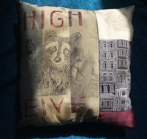 raccoon high five pillow