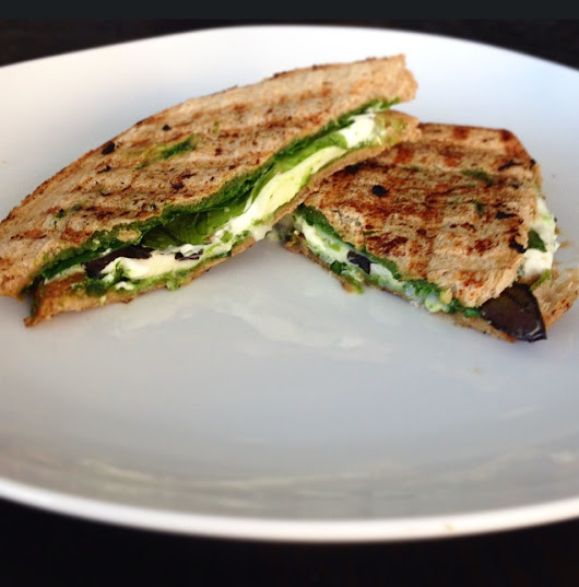 Spinach, avocado, goat and mozzarella cheese sandwich with spinach pesto