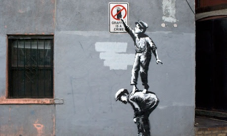 British graffiti artist Banksy revealed Tuesday his first work in what he described as an exhibition on walls throughout New York.