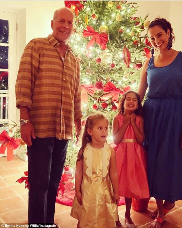 Happy daddy: Bruce Willis and wife Emma with their two daughters  Evelyn, aged three, and Mabel, aged five, on Christmas day