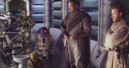 Bail Organa, Obi-Wan Kenobi, Yoda, C-3P0 and R2-D2 watch over an injured Padme (off-screen) in the Polis Massan medical facility.