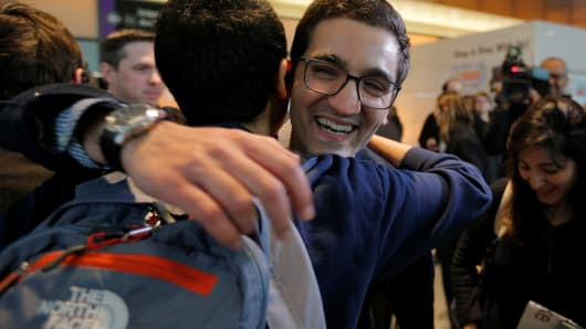 Behnam Partopour, a Worcester Polytechnic Institute (WPI) student from Iran, is greeted by friends at Logan Airport after he cleared U.S. customs and immigration on an F1 student visa in Boston, Massachusetts. Partopour was originally turned away from a flight to the U.S. following President Donald Trump's executive order travel ban.